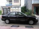 Tp. Hồ Chí Minh: Cần Bán Ford Laser 1.8 ghia màu đen số Tự động cuối 2004, xe còn rất mới RSCL1098854