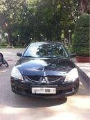 Tp. Hồ Chí Minh: Bán xe Mitsubishi Lancer màu đen. sản xuất cuối 2003. số tự động. Xe gia đình CL1091942P5