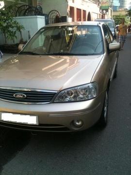 Bán xe Ford Laser GHia 1. 8, màu ghi vàng. Đời xe 2005, mua mới 2007